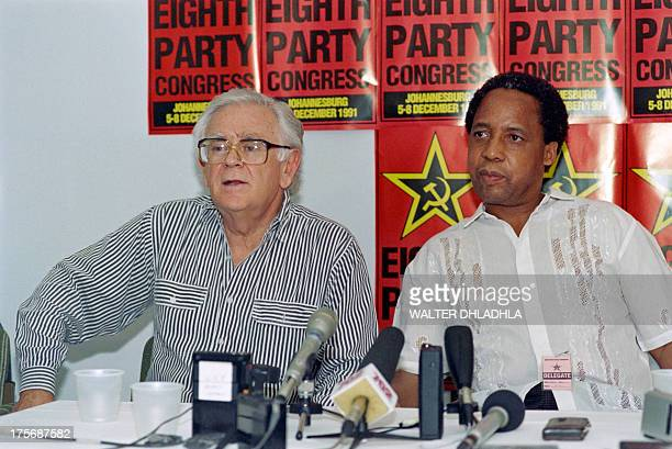 Newly elected secretary general of South African Communist Party Chris Hani and former secretary general Joe Slovo speak at a press conference on the...