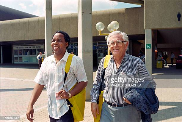 Newly elected secretary general of South African Communist Party Chris Hani and former secretary general Joe Slovo walk together after addressing the...