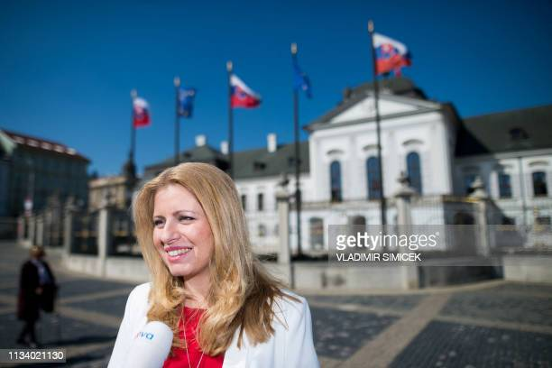 Newly elected Slovakia's President elect Zuzana Caputova speaks to a journalist in the front of the Presidential palace in Bratislava Slovakia on...