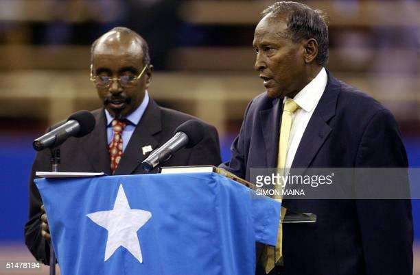 Newly elected Somali president Abdullahi Yusuf Ahmed is sworn in by Somali parliament speaker Sharif Hassan Sheikh Aden in Nairobi 14 October 2004...