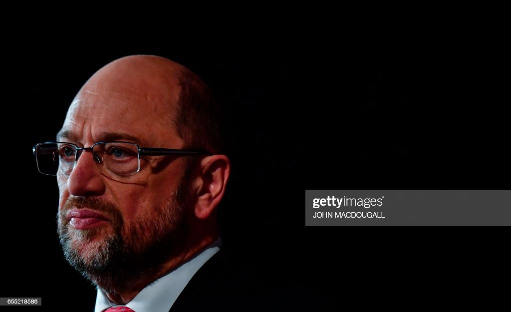Newly elected SPD leader and candidate for Chancellor of Germany's social democratic SPD party Martin Schulz gives a TV interview after his election at the Congress of Germany's Social Democratic Party (SPD) on March 19, 2017 in Berlin. / AFP PHOTO / John MACDOUGALL