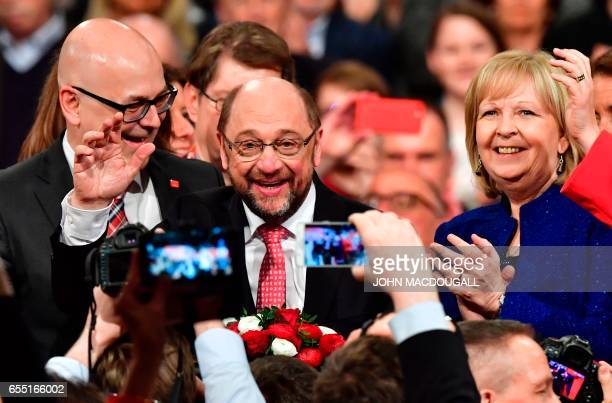Newly elected SPD president and candidate for Chancellor of Germany's social democratic SPD party Martin Schulz cheers with SchleswigHolstein State...