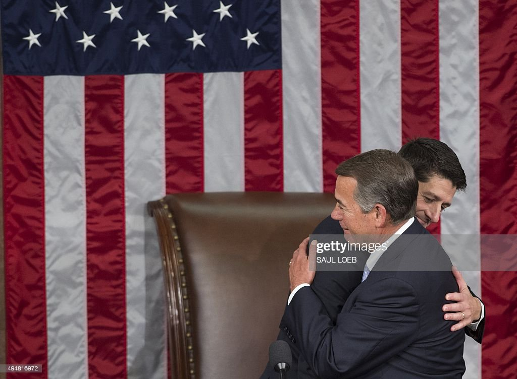 Newly elected Speaker of the House Paul Ryan, Republican of Wisconsin, (L) hugs outgoing Speaker John Boehner, Republican of Ohio, after being elected Speaker in the House Chamber at the US Capitol in Washington, DC, October 29, 2015.