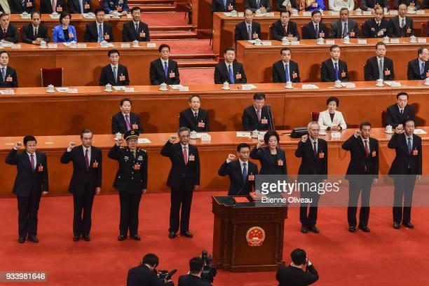 Newly elected state councilors Zhao Kezhi Wang Yi Wei Fenghe Vice Premier Hu Chunhua Sun Chunlan Liu He and state councillors Wang Yong Xiao Jie led...