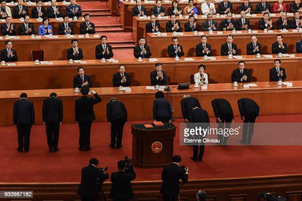 Newly elected state councilors Zhao Kezhi Wang Yi Wei Fenghe Vice Premier Hu Chunhua Sun Chunlan Liu He Han Zheng and state councillors Wang Yong and...