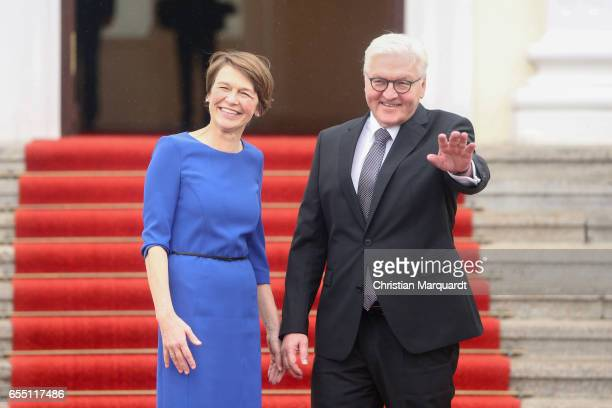 Newly elected state German President FrankWalter Steinmeier and partner Elke Buedenbender are welcomed by outgoing President Joachim Gauck and his...