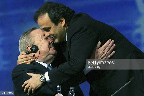 Newly elected UEFA President and former French football star Michel Platini gives hugs former president Lennart Johansson after the presidential...