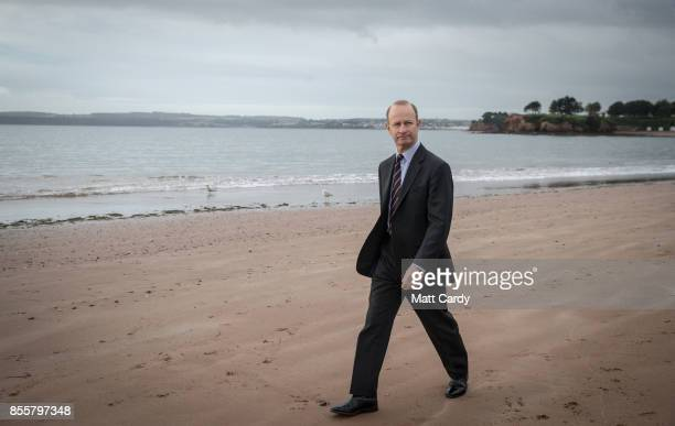 Newly elected UKIP leader Henry Bolton walks on the beach following morning TV interviews at their autumn conference on September 30 2017 in Torquay...