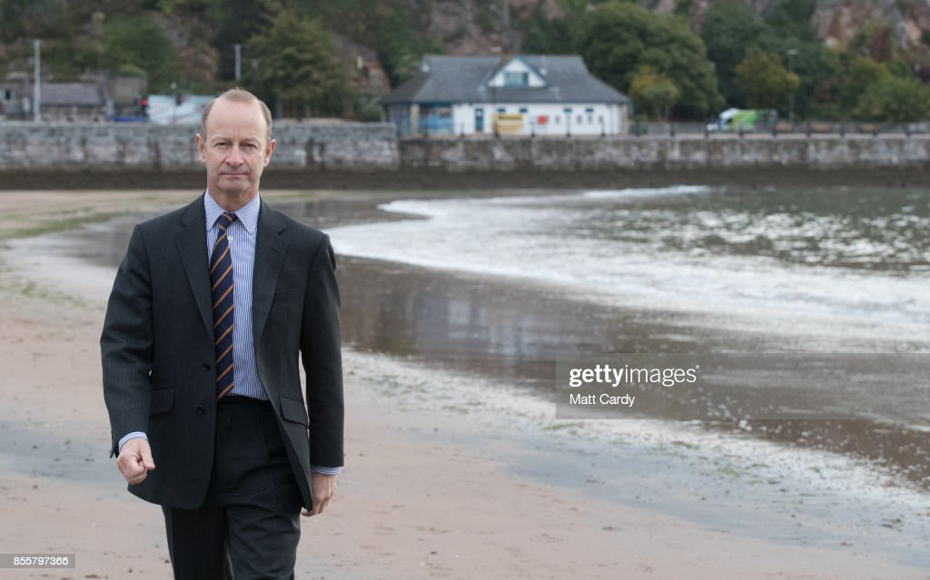 Newly elected UKIP leader Henry Bolton walks on the beach following morning TV interviews at their autumn conference on September 30, 2017 in Torquay, England. Bolton is the UKIP party's fourth leader in just over a year.
