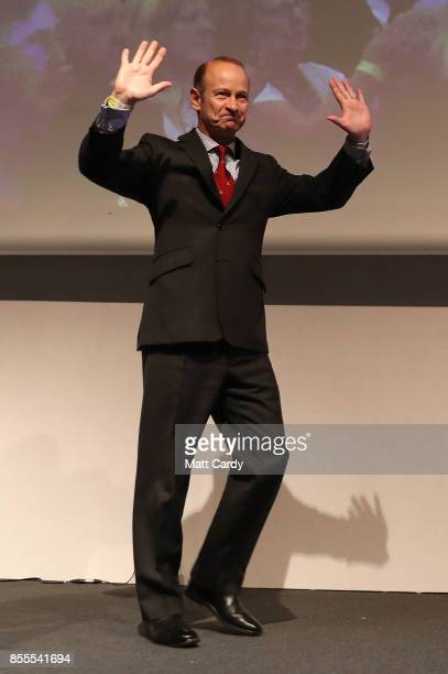 Newly elected UKIP leader Henry Bolton waves to the crowd after speaking at their autumn conference on September 29 2017 in Torquay England Bolton is...