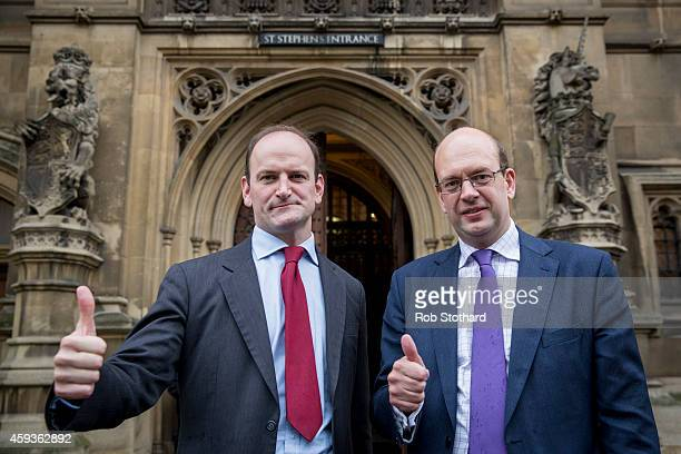 Newly elected United Kingdom Independence Party MP Mark Reckless and Douglas Carswell MP pose for a portrait outside the Houses of Parliament on...