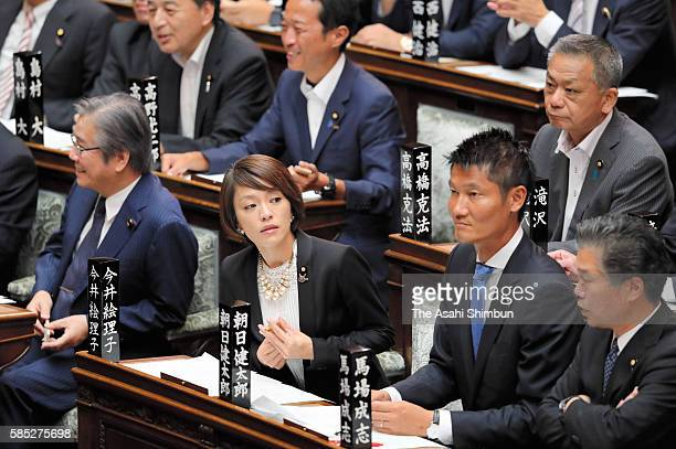 Newly elected upper house lawmaker Eriko Imai and Kentaro Asahi are seen at the House of Councillors plenary session as the 191st Diet session begins...
