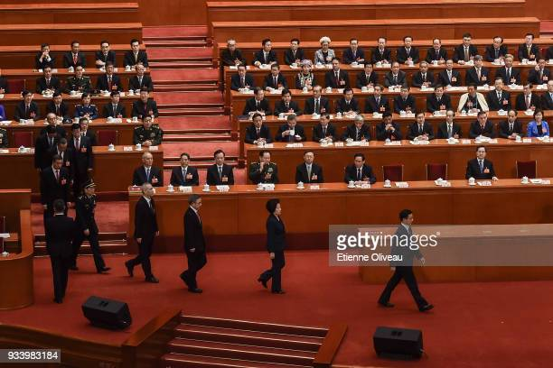 Newly elected Vice Premier Han Zheng followed by Vice Premier Sun Chunlan Hu Chunhua and Liu He State councilors Wei Fenghe Wang Yong Wang Yi Zhao...