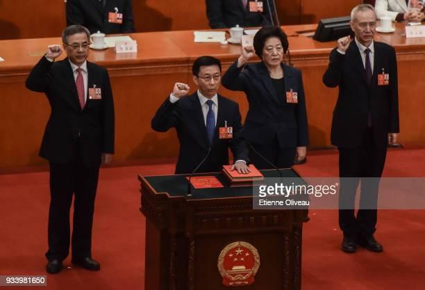 Newly elected Vice Premiers Hu Chunhua, Han Zheng, Sun Chunlan and Liu He swear an oath during the seventh plenary session of the 13th National...