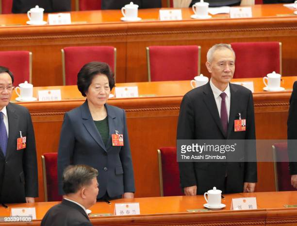 Newly elected Vice Premiers Sun Chunlan and Liu He swear an oath during the seventh plenary session of the 13th National People's Congress at the...