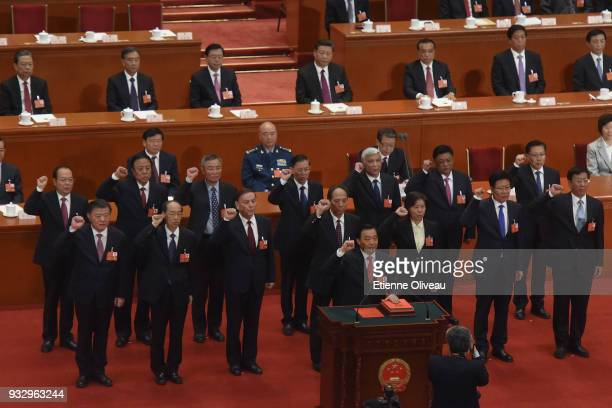 Newly elected vicechairmen of the National People's Congress led by Wang Chen swears under oath after being elected during the 5th plenary session of...