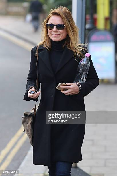 Newly Engagaed Geri Halliwell displaying her diamond engagement ring as she's pictured in North London on November 19 2014 in London England