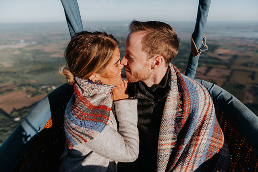 Newly engaged couple in hot air balloon - gettyimageskorea