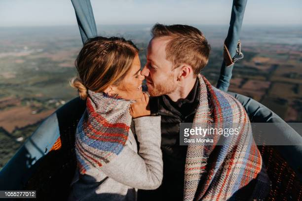 newly engaged couple in hot air balloon - balloon ride stock pictures, royalty-free photos & images