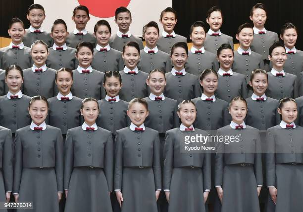 Newly enrolled students of the Takarazuka Music School gather for a group photo during an entrance ceremony held in Takarazuka Hyogo Prefecture...