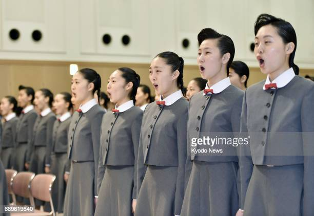 Newly enrolled students of the Takarazuka Music School sing the school anthem during the entrance ceremony at the school in Takarazuka Hyogo...