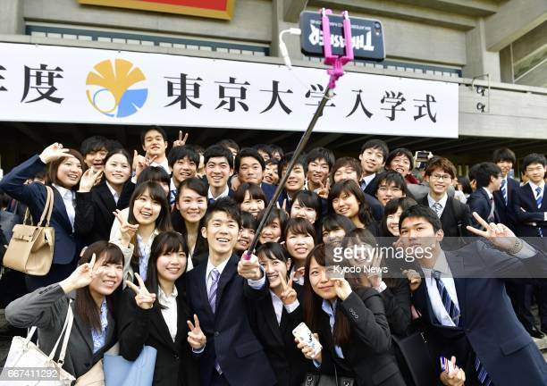 Newly enrolled students of the University of Tokyo Japan's most prestigious national university pose for a selfie before the start of the entrance...