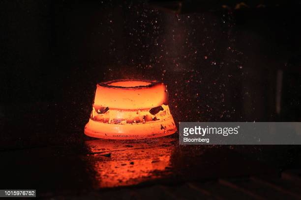 A newly forged hot steel bearing component is sits in a cooling shower inside the Schaeffler AG factory in Schweinfurt Germany on Tuesday July 3 2018...