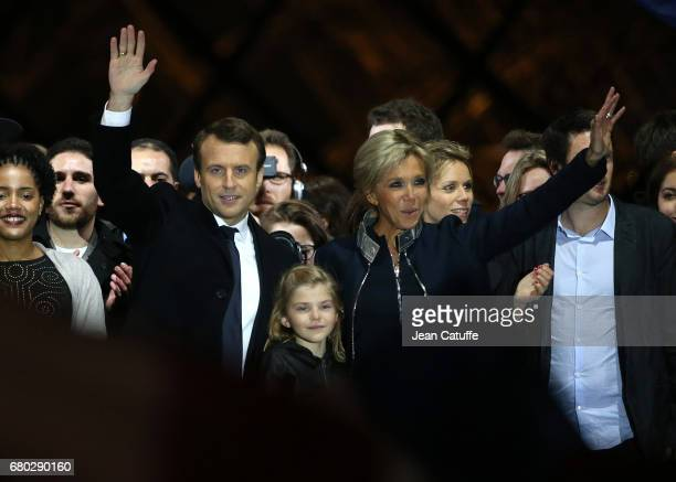 Newly French President elected Emmanuel Macron, his wife Brigitte Macron, her grand daughter Emma and her other daughter Tiphaine Auziere celebrate...