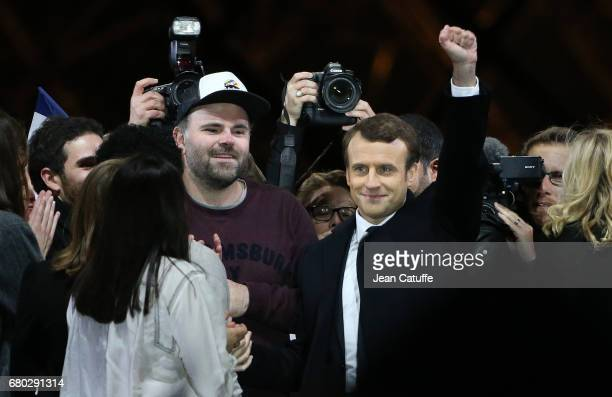 Newly French President elected Emmanuel Macron with Morgan Simon celebrate his presidential election victory at Le Louvre plaza on May 7 2017 in...