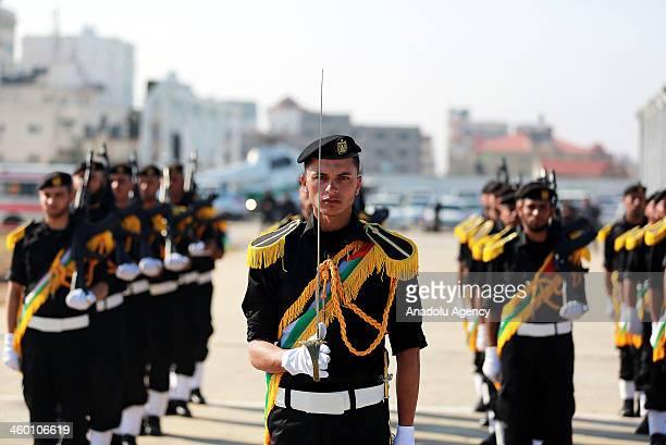 A newly graduate Palestinian soldier leads the group of soldiers with his sword during the graduation ceremony of the new security forces for the...