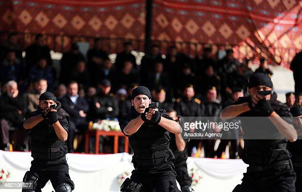 Newly graduate Palestinian soldiers perform their skills during the graduation ceremony on January 2 in Gaza