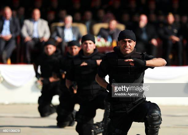 Newly graduate soldiers for Palestinian government's security force perform their skills during the graduation ceremony on January 2 in Gaza