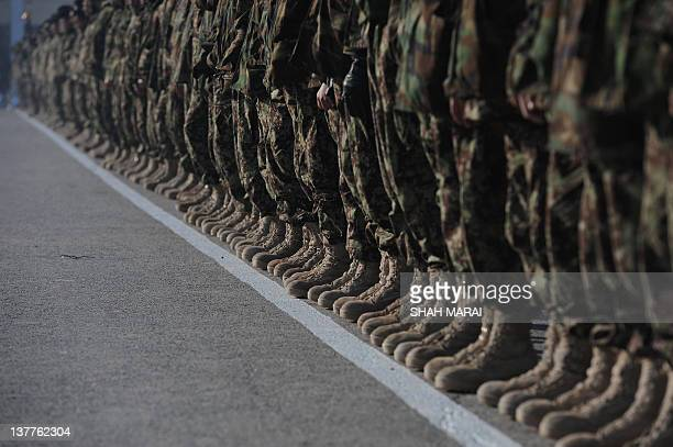 Newly graduated Afghan National Army soldiers stand in line during their graduation ceremony at the Afghan National Army training centre in Kabul on...