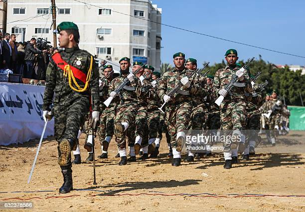 Newly graduated army officers attend a military parade during their graduation ceremony organized by the Palestinian Interior Ministry in Gaza City...