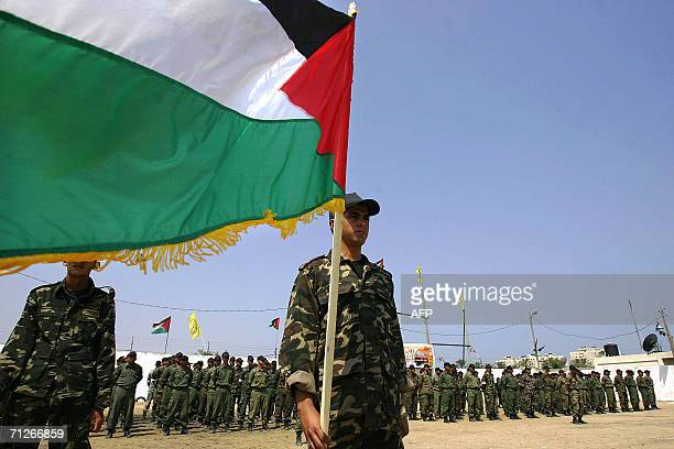 Newly graduated Palestinian security force officers take part in their graduation ceremony 22 June 2006 in Gaza City Israel's air force commander...