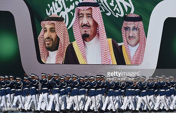 Newly graduated Saudi air force officers march in front of a banner bearing portraits of King Salman bin Abdulaziz Crown Prince Mohammed bin Nayef...