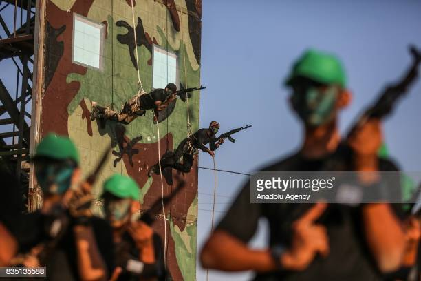 Newly graduates Palestinian trainees perform military drill during their graduation ceremony of the summer camp of Izz adDin alQassam Brigades...
