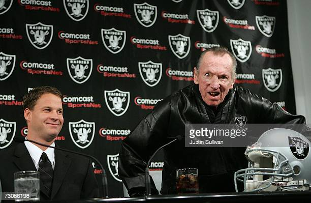 Newly hired head coach of the Oakland Raiders Lane Kiffin smiles as Raiders owner Al Davis reacts to a question during a press conference on January...
