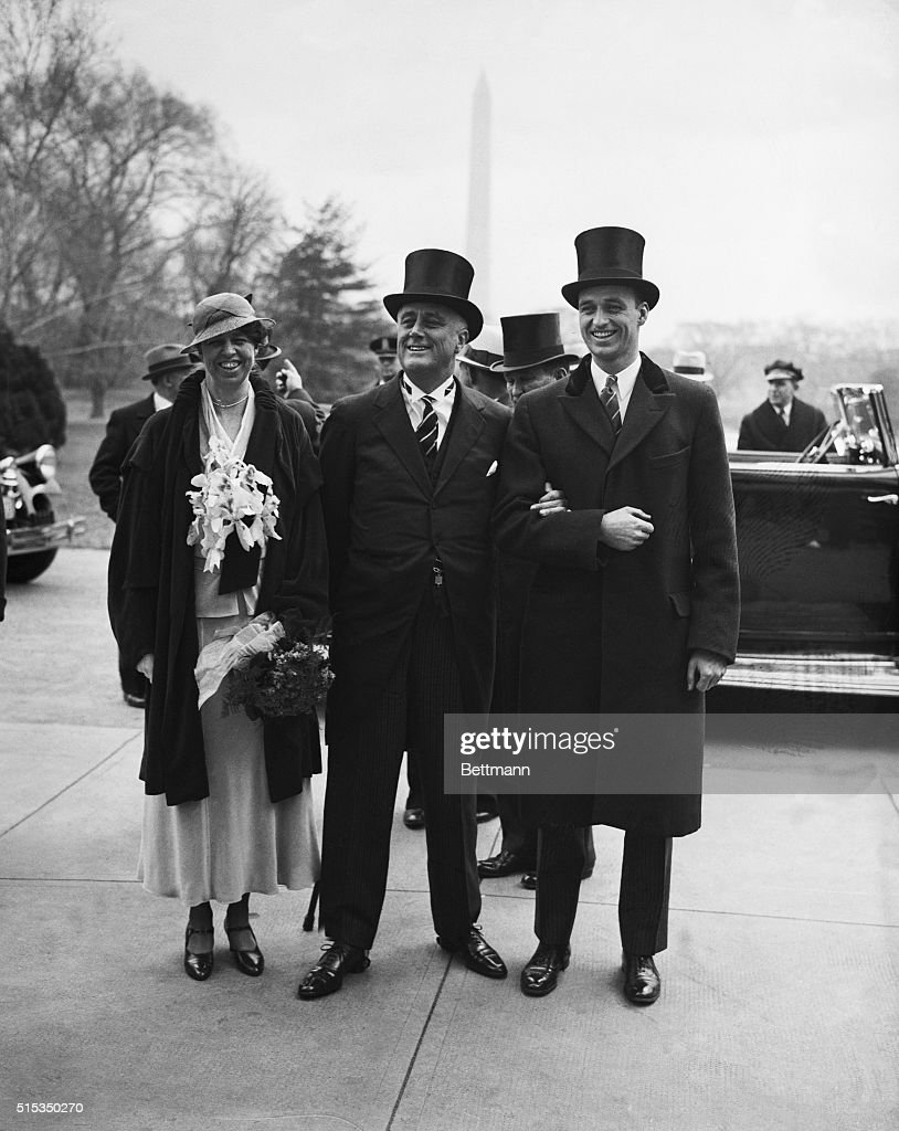 Newly inaugurated President Franklin Delano Roosevelt enters the White House arm in arm with his wife Eleanor and son James.