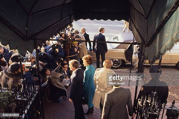 Newly inaugurated US President Jimmy Carter and First Lady Rosalynn Carter greet supporters as they leave Blair House to attend the Inaugural Parade...