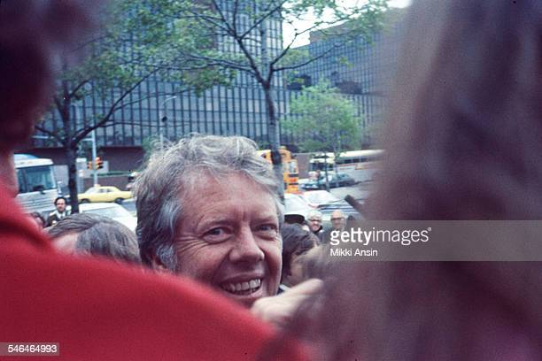 Newly inaugurated US President Jimmy Carter smiles as he leaves Blair House to attend the Inaugural Parade Washington DC January 20 1977