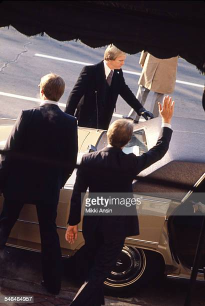 Newly inaugurated US President Jimmy Carter waves as he leaves Blair House to attend the Inaugural Parade Washington DC January 20 1977