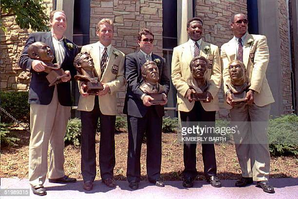Newly inducted Pro Football Hall of Fame enshrinees Henry Jordan Jr accepting for his deceased father Henry Jordon Steve Largent Jim Finks Jr...