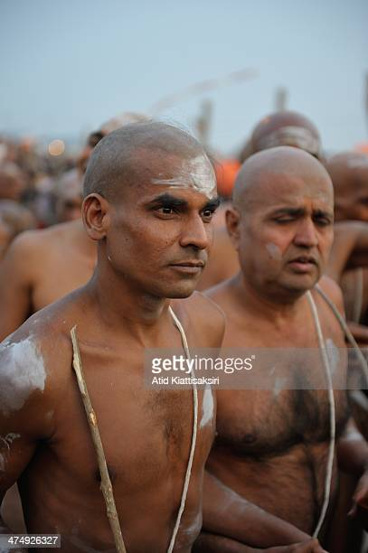 Newly initiated Naga Sadhus march in their initiation ceremony at the Sangam the confluence of Ganges Yamuna and mythical saraswati rivers during...