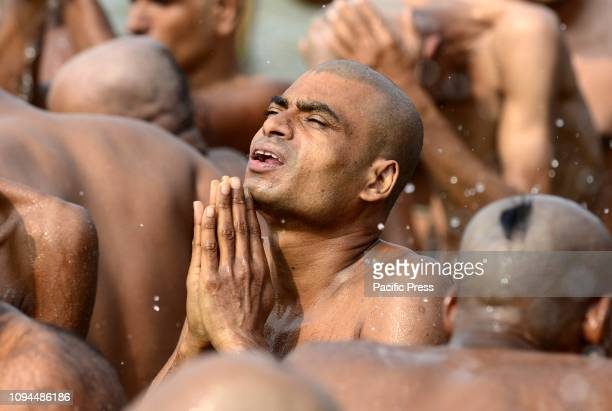 Newly initiated Naga Sadhus perform Ritual at Bank of River Ganga during ongoing Kumbh festival in Allahabad .