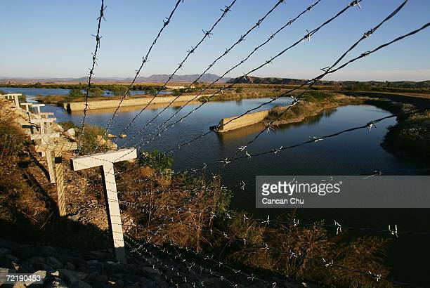 A newly installed fence constructed by the Chinese government divides the border from North Korea near the city of Sinuiju on October 17 2006 in...