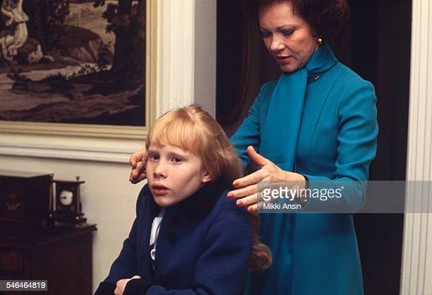 Newly installed First Lady Rosalynn Carter helps her daughter Amy prepare for President Jimmy Carter's Inaugural Parade Washington DC January 20 1977