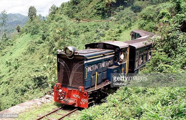 A newly introduced diesel engine pulls the vintage 'toy train' running between the Himalayan hill station of Darjeeling and Siliguri in the eastern...