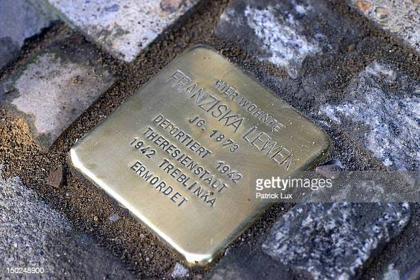 Newly laid 'Stolperstein' memorial cobblestone outside a residence on August 13, 2012 in Hamburg, Germany. Each stone has a brass plaque...