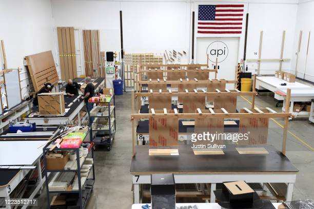 Newly manufactured acrylic social distancing guards sit on workbenches at Architectural Plastics on May 07 2020 in Petaluma California Architectural...